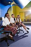 Portrait of three teenage girl students wearing uniforms in a classroom Stock Photo - Premium Royalty-Free, Artist: Brian Pieters, Code: 638-01584689