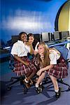 Portrait of three teenage girl students wearing uniforms in a computer classroom Stock Photo - Premium Royalty-Free, Artist: Brian Pieters, Code: 638-01584693