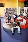 Group of high school students hanging out in library with teacher Stock Photo - Premium Royalty-Free, Artist: Brian Pieters, Code: 638-01584713