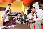 Group of high school students hanging out in library with teacher Stock Photo - Premium Royalty-Free, Artist: Brian Pieters, Code: 638-01584715