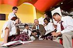 Group of high school students hanging out in library with teacher Stock Photo - Premium Royalty-Free, Artist: Brian Pieters, Code: 638-01584716