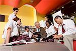 Group of high school students in library with teacher Stock Photo - Premium Royalty-Free, Artist: Brian Pieters, Code: 638-01584717