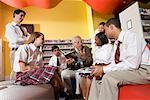 Group of high school students in library with teacher Stock Photo - Premium Royalty-Free, Artist: Brian Pieters, Code: 638-01584721