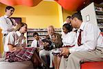 Group of high school students in library with teacher Stock Photo - Premium Royalty-Free, Artist: Brian Pieters, Code: 638-01584722