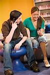 Teenagers using their cellphones Stock Photo - Premium Royalty-Free, Artist: Brian Pieters, Code: 638-01584754