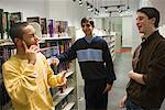 Three teenage boys conversing in a library Stock Photo - Premium Royalty-Free, Artist: Brian Pieters, Code: 638-01584768