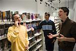 Three teenage boys conversing in a library Stock Photo - Premium Royalty-Free, Artist: Brian Pieters, Code: 638-01584769