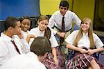 Group of high school students in uniforms conversing Stock Photo - Premium Royalty-Free, Artist: Brian Pieters, Code: 638-01584775