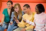 Group of teenagers with their cellphones Stock Photo - Premium Royalty-Free, Artist: Brian Pieters, Code: 638-01584802