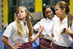 Three teenage girl students wearing uniforms hanging out in a library Stock Photo - Premium Royalty-Free, Artist: Brian Pieters, Code: 638-01584820