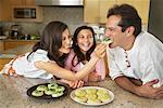 Mother, Father and Daughter in Kitchen    Stock Photo - Premium Rights-Managed, Artist: Mark Leibowitz, Code: 700-01585851