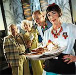 Waitress Serving Food to People    Stock Photo - Premium Rights-Managed, Artist: Brian Kuhlmann, Code: 700-01585945