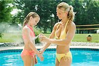 Mother Applying Sunscreen to Daughter    Stock Photo - Premium Rights-Managednull, Code: 700-01586018