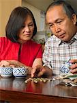 Couple Counting Coins in Restaurant    Stock Photo - Premium Royalty-Free, Artist: Masterfile, Code: 600-01593541