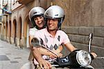 Couple Riding Moped    Stock Photo - Premium Royalty-Free, Artist: Masterfile, Code: 600-01593725