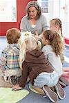 Children Hearing Story at Daycare    Stock Photo - Premium Rights-Managed, Artist: Masterfile, Code: 700-01593826