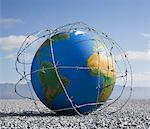 A globe entangled in barbed wire Stock Photo - Premium Royalty-Free, Artist: UpperCut Images, Code: 635-01594293