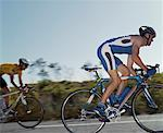Two men racing on bikes