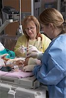 Nurses Practicing with Baby Mannequin    Stock Photo - Premium Royalty-Freenull, Code: 600-01595846