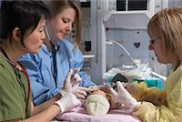 Nurses Practicing on Baby Mannequin    Stock Photo - Premium Royalty-Freenull, Code: 600-01595848
