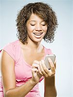 preteen  smile  one  alone - Girl with braces holding cell phone smiling Stock Photo - Premium Royalty-Freenull, Code: 640-01601643