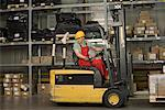 Worker with forklift moving boxes Stock Photo - Premium Royalty-Free, Artist: Kathleen Finlay, Code: 604-01605796