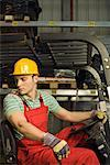 Worker driving forklift Stock Photo - Premium Royalty-Free, Artist: Raymond Forbes, Code: 604-01605824