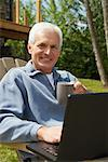 Man with Laptop Computer    Stock Photo - Premium Rights-Managed, Artist: Masterfile, Code: 700-01606184