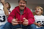 Father and Sons Playing Video Games    Stock Photo - Premium Rights-Managed, Artist: Masterfile, Code: 700-01606639