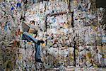 Man reading a paper at a recycling plant. Stock Photo - Premium Royalty-Free, Artist: Siephoto                 , Code: 649-01608511