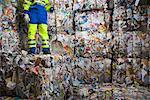 Man with a shovel standing on wall of recycling. Stock Photo - Premium Royalty-Free, Artist: Arcaid, Code: 649-01608516