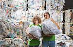 Man and woman at a recycling plant. Stock Photo - Premium Royalty-Free, Artist: Siephoto                 , Code: 649-01608520
