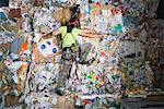 Man climbing a wall of recycling. Stock Photo - Premium Royalty-Free, Artist: Arcaid, Code: 649-01608526