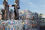 Businessmen shaking hands at a recycling plant. Stock Photo - Premium Royalty-Free, Artist: Arcaid, Code: 649-01608528