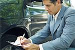 Insurance adjuster inspecting car Stock Photo - Premium Royalty-Freenull, Code: 632-01612751