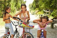 Girls Riding Bicycles    Stock Photo - Premium Royalty-Freenull, Code: 600-01614174