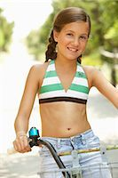 Girl Riding Bicycle Stock Photo - Premium Royalty-Freenull, Code: 600-01614176