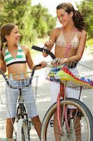 Girls Riding Bicycles    Stock Photo - Premium Royalty-Freenull, Code: 600-01614181