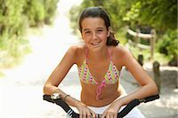 Girl Riding Bicycle Stock Photo - Premium Royalty-Freenull, Code: 600-01614182