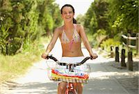 Girl Riding Bicycle Stock Photo - Premium Royalty-Freenull, Code: 600-01614186