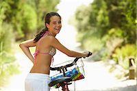 Girl Riding Bicycle Stock Photo - Premium Royalty-Freenull, Code: 600-01614187