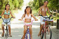 Girls Riding Bicycles    Stock Photo - Premium Royalty-Freenull, Code: 600-01614198