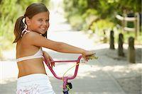 Girl Riding Bicycle    Stock Photo - Premium Royalty-Freenull, Code: 600-01614199