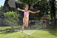 preteen girl feet - Family playing in backyard with sprinkler    Stock Photo - Premium Royalty-Freenull, Code: 600-01614314