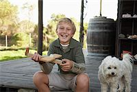 Portrait of Boy With Dog and Model Airplane    Stock Photo - Premium Royalty-Freenull, Code: 600-01614640