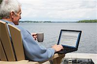 Man at the Cottage, Using Laptop Computer    Stock Photo - Premium Rights-Managednull, Code: 700-01615218
