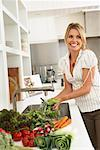 Woman in Kitchen, Preparing Food    Stock Photo - Premium Royalty-Free, Artist: Masterfile, Code: 600-01616945