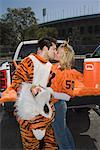 Kissing mascot couple Stock Photo - Premium Royalty-Free, Artist: UpperCut Images, Code: 621-01618866