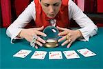 Casino dealer with crystal ball and investment playing cards Stock Photo - Premium Royalty-Free, Artist: photo division, Code: 604-01629893