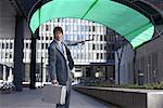 Businessman Holding Parafoil    Stock Photo - Premium Royalty-Free, Artist: Jerzyworks, Code: 600-01630175